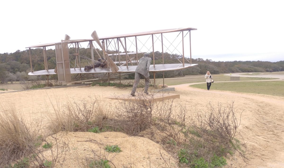 A recreation of the Wright Brothers flying a plane