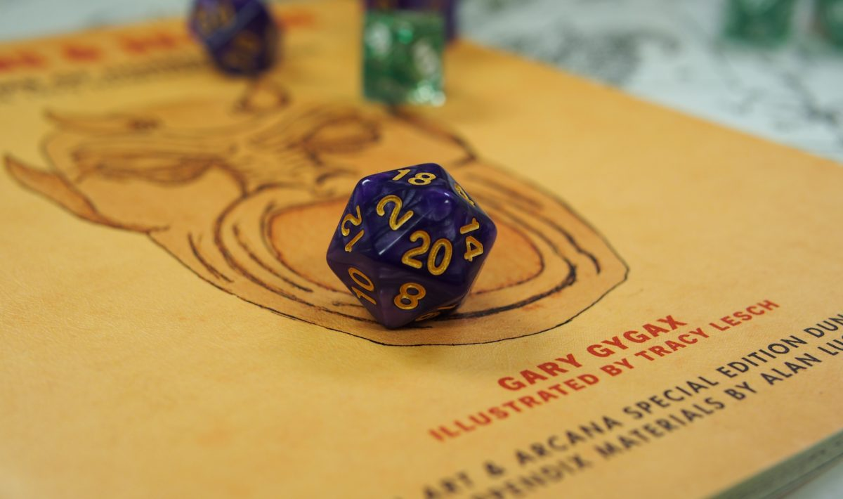 Original Dungeons & Dragons manual with twenty-sided die