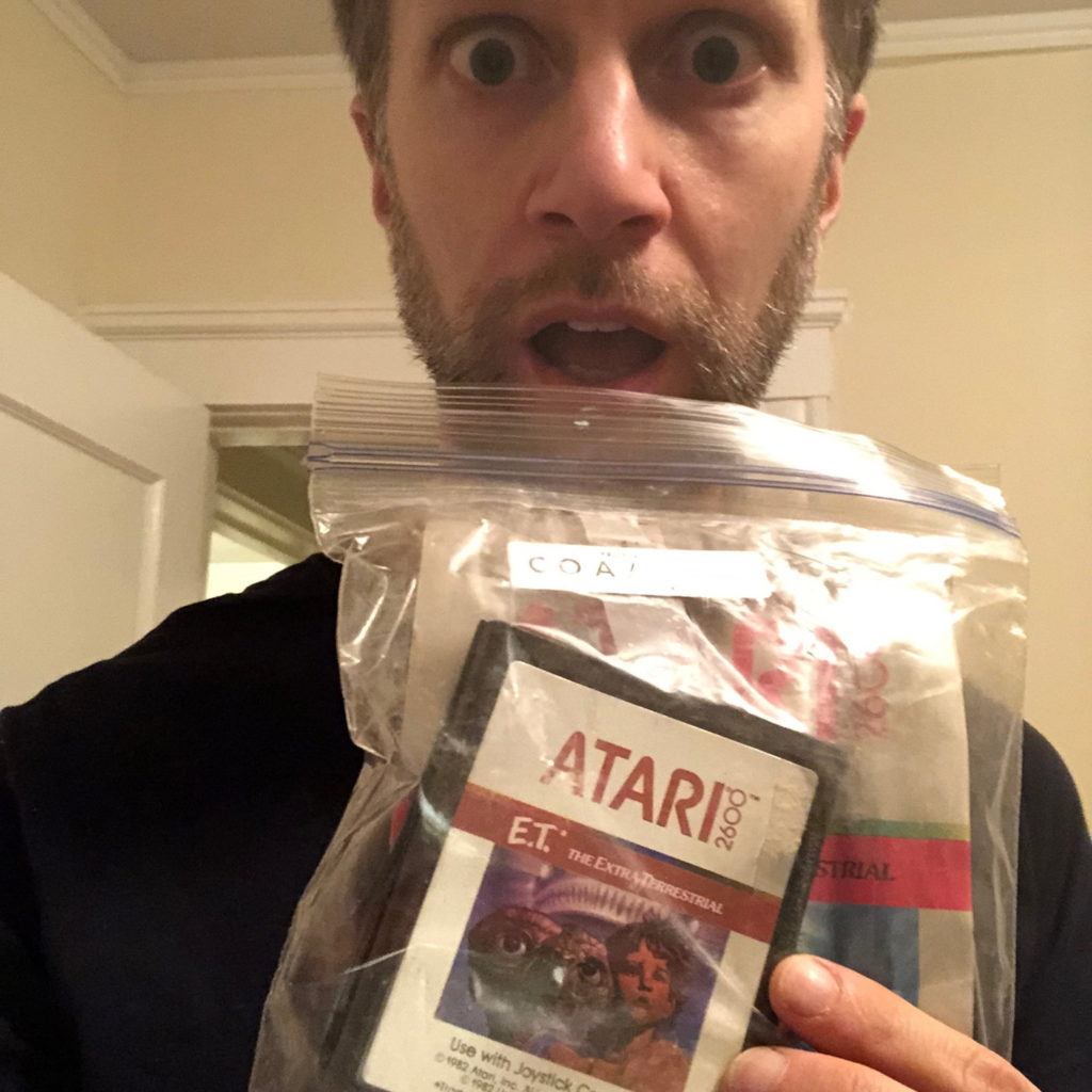An E.T. cartridge from Alamagordo in the plastic bag, being held by Ken