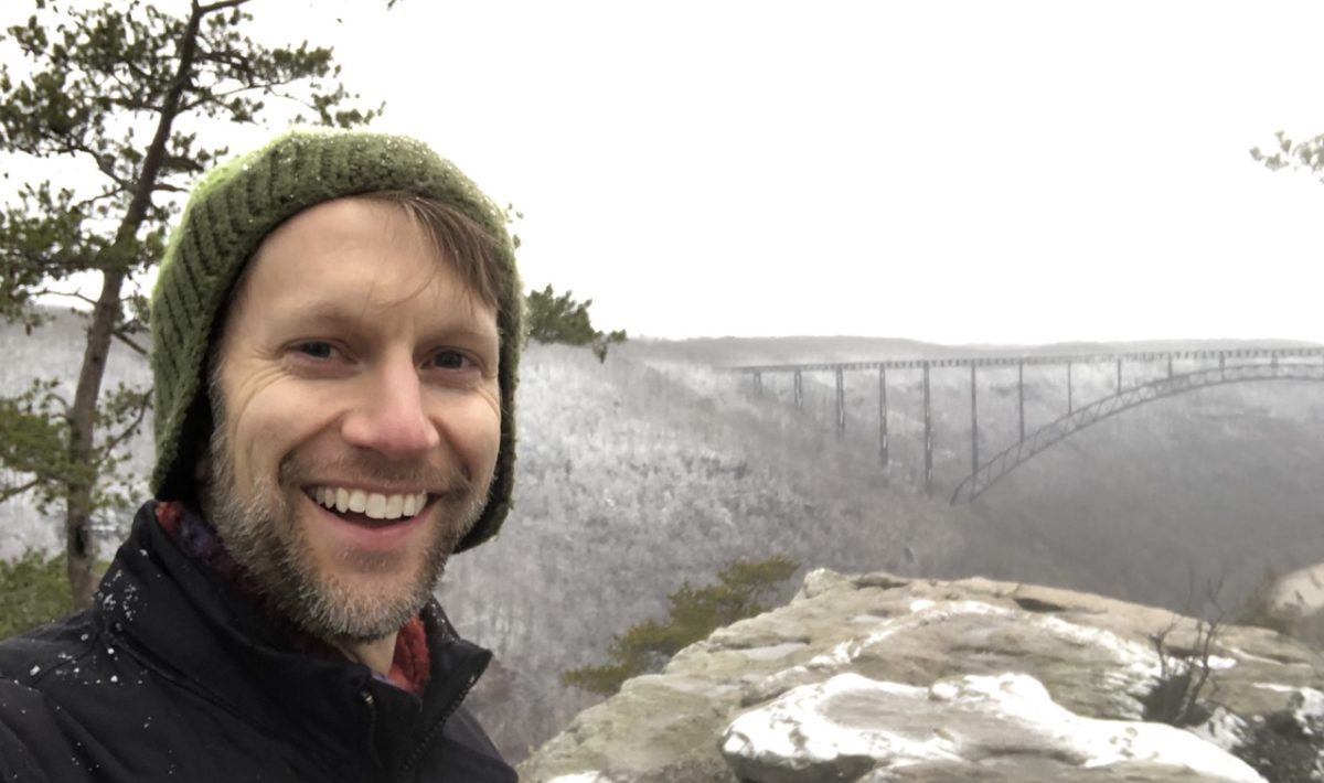 Selfie of Ken with New River Gorge Bridge in the background