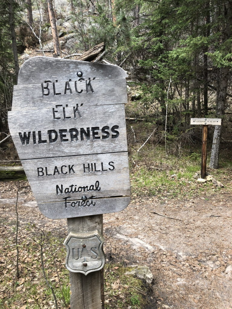 A wooden sign at the entrance to Black Elk Wilderness