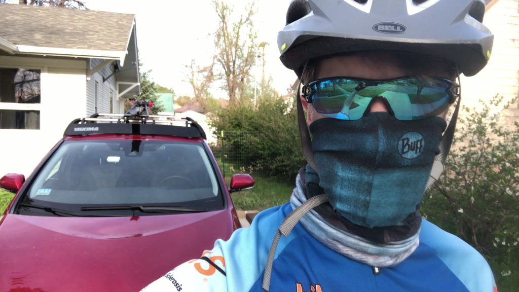 Ken wearing mask, sunglasses, and cycling helmet