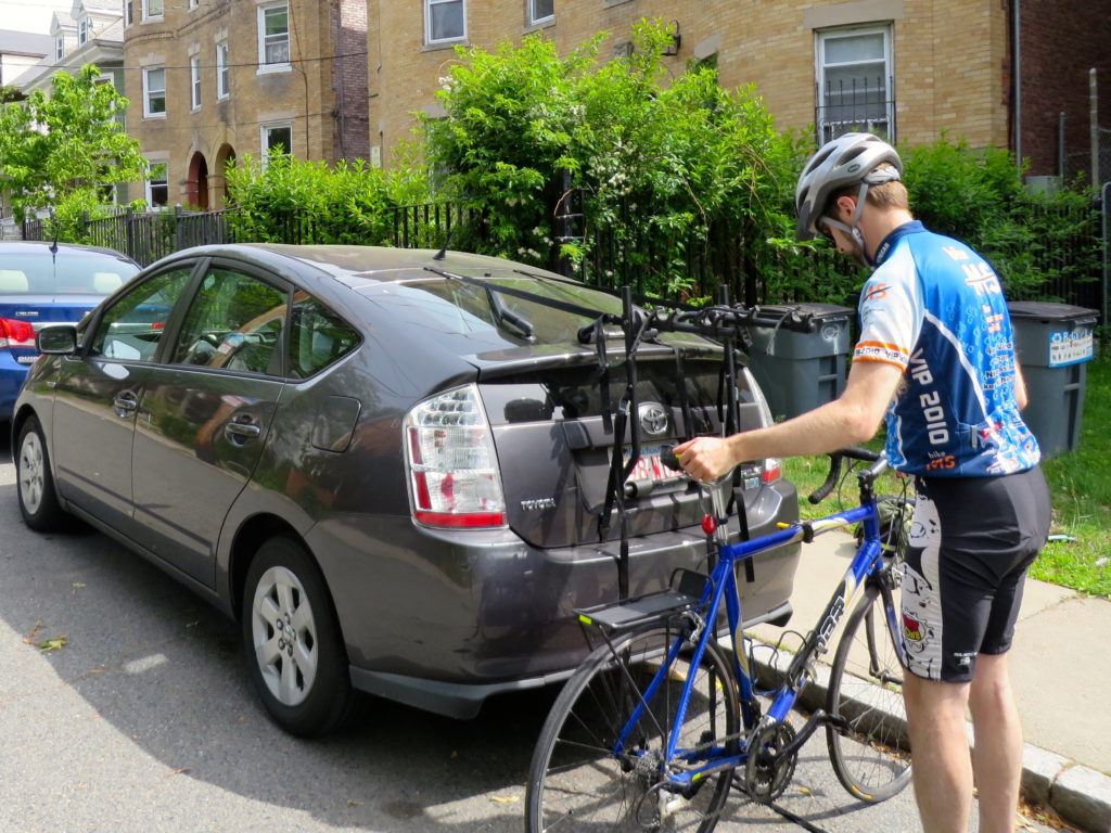 Ken taking his bike off the back of his 2007 Toyota Prius