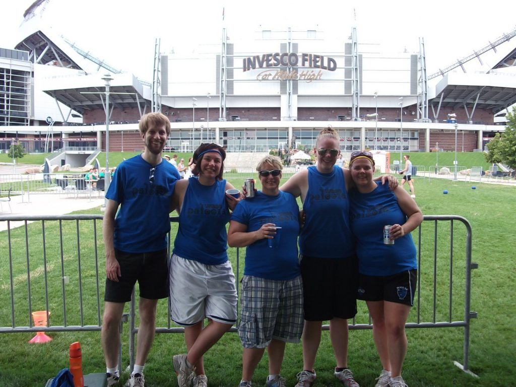 Ken and four blue-shirted athletes at Denver's Invesco Field