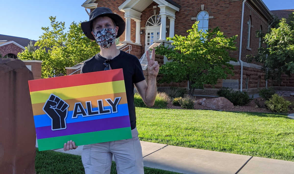 "Ken holding ""Ally"" sign"