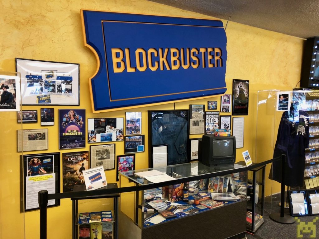 A museum display of Blockbuster and movie artifacts