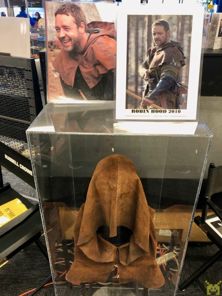 A glass case with the leather hood Russell Crowe wore in the Robin Hood movie