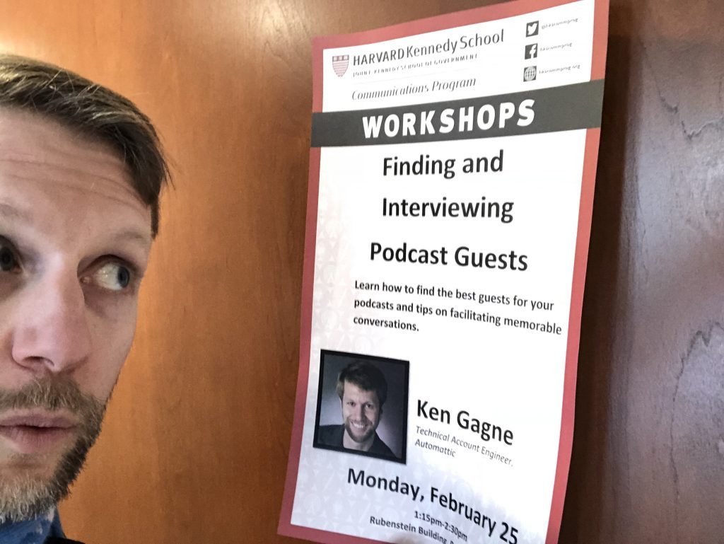 Ken looking at poster advertising his own workshop