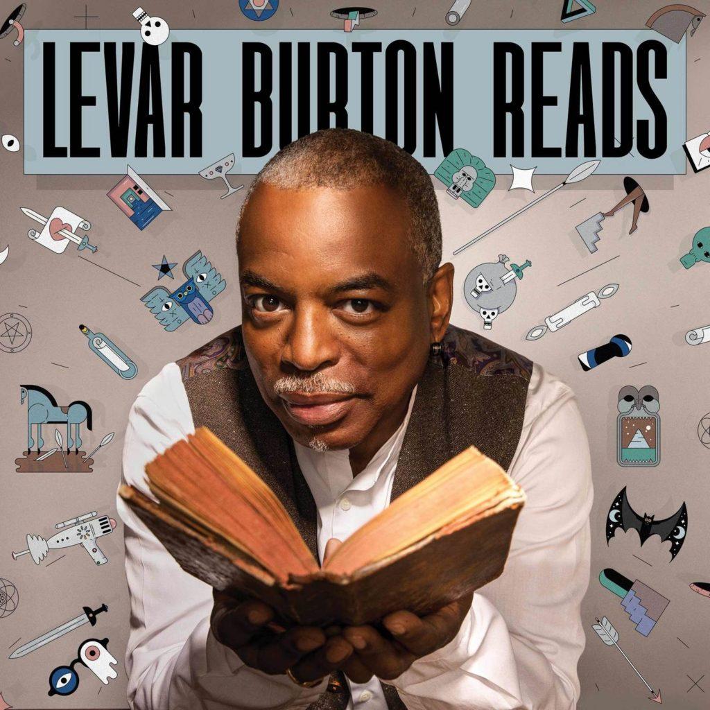 LeVar Burton holding an open book
