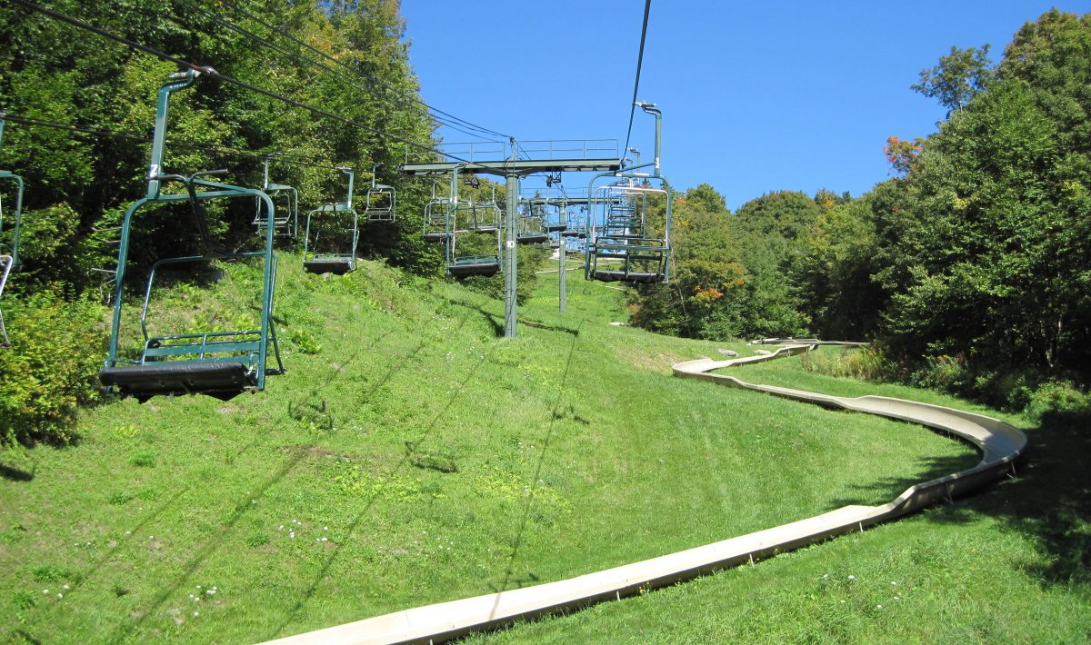 Looking up a mountain at its chairlift